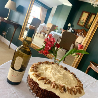 A Lagavulin Distillery 16 year old cake for today's guests arriving.   There's a near dilemma with the bottle though..... it's low!!   Thank goodness the not drinking inside doesn't count in food! #waysandmeans #cake #welcome #islay #lagavulin